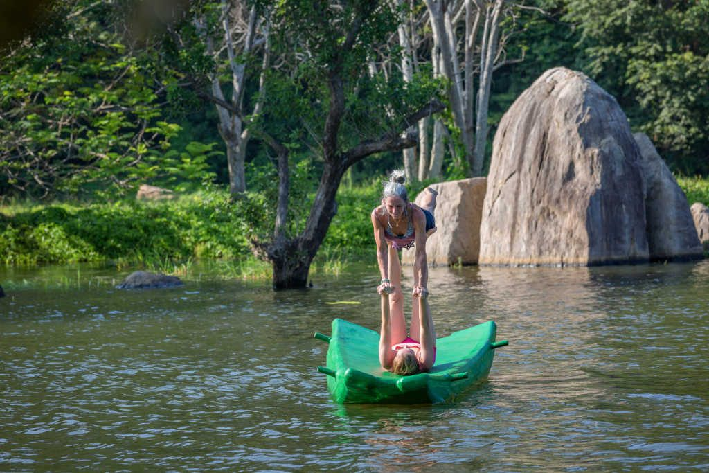 Acroyoga on boat at Ulpotha Yoga retreat Sri Lanka