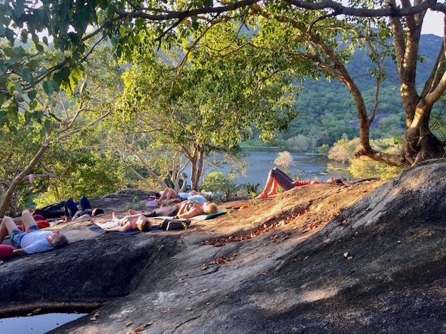 Guided meditation outdoors at Ulpotha yoga retreat Sri Lanka