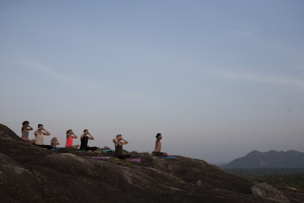 Outdoor yoga class in Sri Lanka at Ulpotha retreat