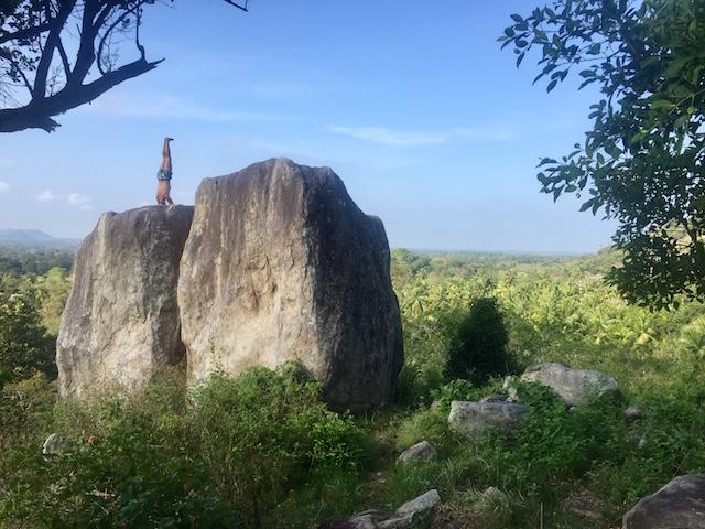 Yoga headstand in nature at Ulpotha retreat Sri Lanka