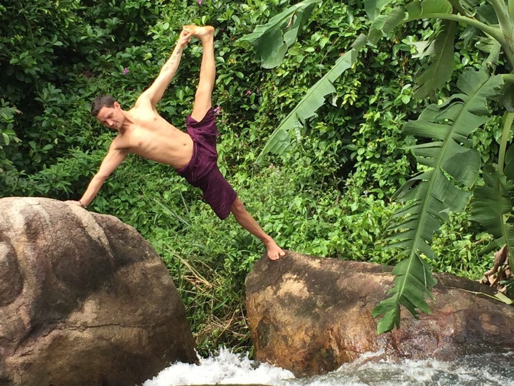 Vasisthasana (side plank pose) over running water at Ulpotha Sri Lanka