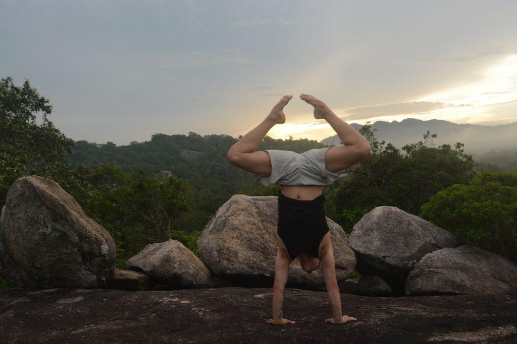Adho Mukha Vrksasana (handstand) on Monkey Rock at Ulpotha yoga retreat